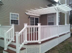 Decks NJ composite deck with white vinyl railings